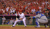Kole Calhoun of the Los Angeles Angels of Anaheim pops up a bunt attempt during the game against the Kansas City Royals during Game One of the...