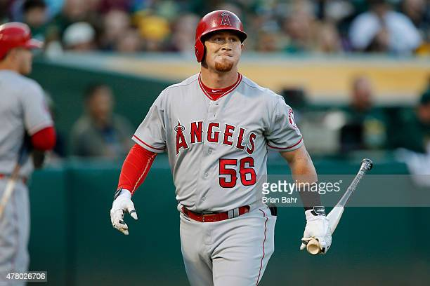 Kole Calhoun of the Los Angeles Angels of Anaheim reacts after striking out against the Oakland Athletics in the third inning at Oco Coliseum on June...