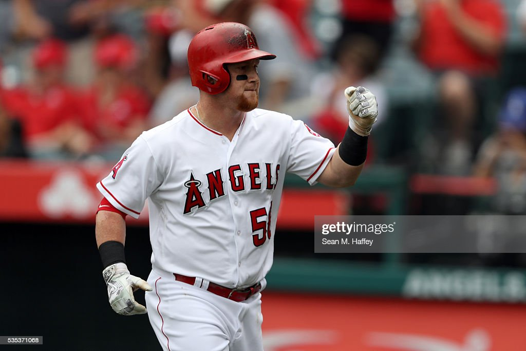 Kole Calhoun #56 of the Los Angeles Angels of Anaheim reacts to a solo home run during the first inning of a baseball game between the Los Angeles Angels of Anaheim and the Houston Astros at Angel Stadium of Anaheim on May 29, 2016 in Anaheim, California.
