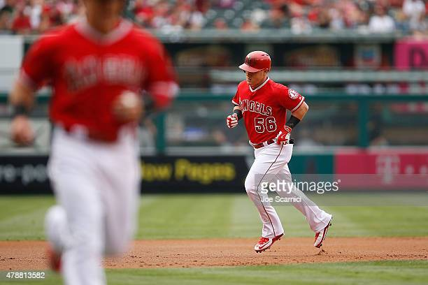 Kole Calhoun of the Los Angeles Angels runs the bases after hitting a two run homerun in the first inning against the Seattle Mariners at Angel...