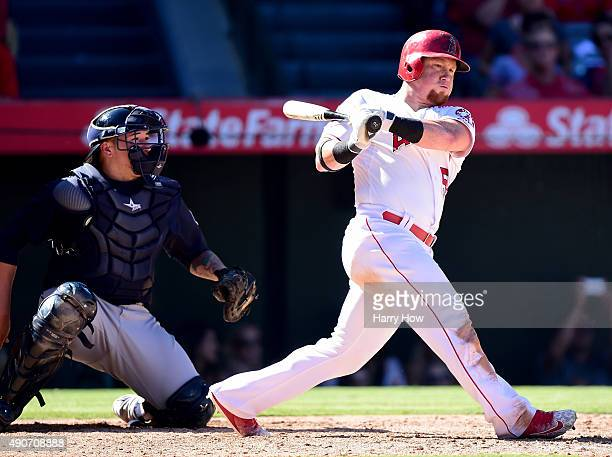 Kole Calhoun of the Los Angeles Angels singles in a run in front of John Hicks of the Seattle Mariners to take a 32 lead during the eighth innin at...