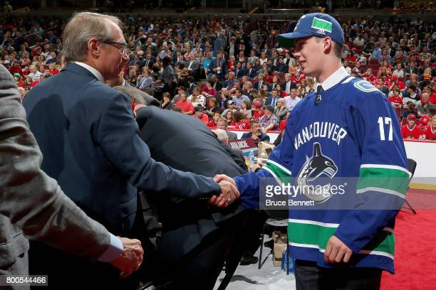 Kole Lind meets with Vancouver Canucks executives after being selected 33rd overall during the 2017 NHL Draft at the United Center on June 24 2017 in...
