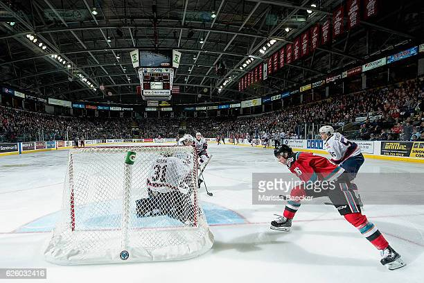 Kole Lind of the Kelowna Rockets attempts a wrap around goal during third period on Tyler Brown of the Regina Pats on November 26 2016 at Prospera...