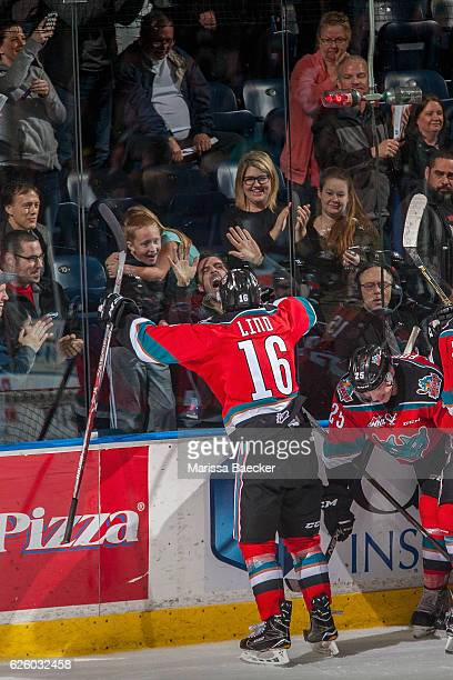 Kole Lind of the Kelowna Rockets celebrates an overtime winning goal against the Regina Pats with fans on November 26 2016 at Prospera Place in...