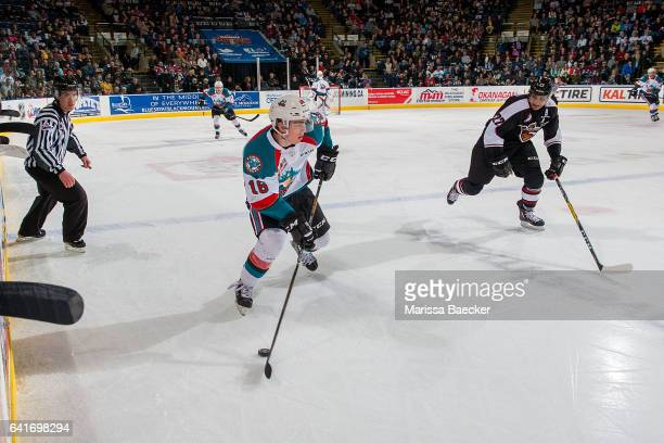 Kole Lind of the Kelowna Rockets skates up ice along the boards looking for the pass against Calvin Spencer of the Vancouver Giants on February 10...