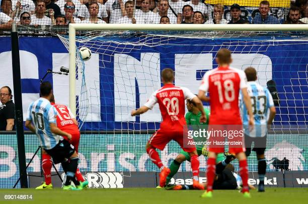 Kolja Busch of Jahn Regensburg scores the opening goal during the Second Bundesliga Playoff second leg match betweenTSV 1860 Muenchen and Jahn...