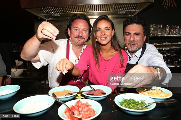 Kolja Kleeberg and Janina Uhse and Shan Rahimkhan cook during the MasterCard Priceless Fashion Kitchen Party at Shan Rahimkhan's Bistro during the...