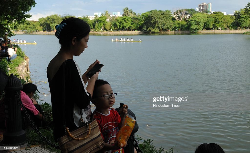Kolkata Chinese community enjoy boat race during Chinese Dragon Boat Festival at Rabindra Sarobar on June 26, 2016 in Kolkata, India. Kolkata has a largest Chinese population in India. Dragon Boat Race festival was started last year at Tiretti Bazaar, but this is first time boat race was being held. A crucial tie-up was done with Calcutta Rowing Club to host the first ever Dragon Boat Race at Rabindro Sarobor Lake.