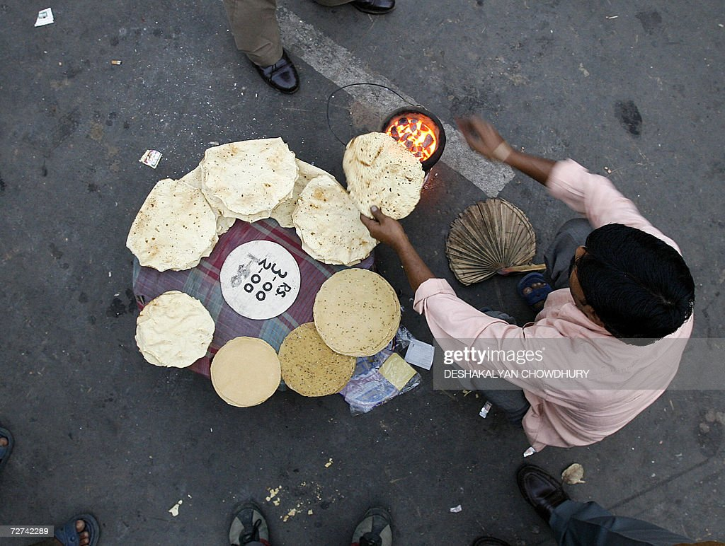 an n vendor sells street food outsi pictures getty images an n vendor sells street food outside a political gathering in kolkata 06 2006