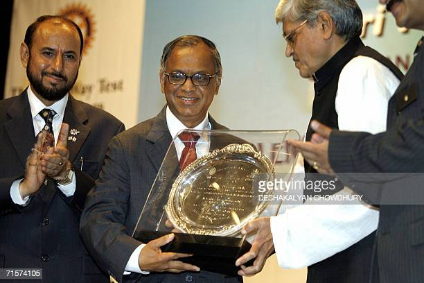 Founder and mentor of Infosys Technologies NRNarayana Murthy gestures as Gopal Krishna Gandhi the Governor of West Bengal presents him with the plaue...
