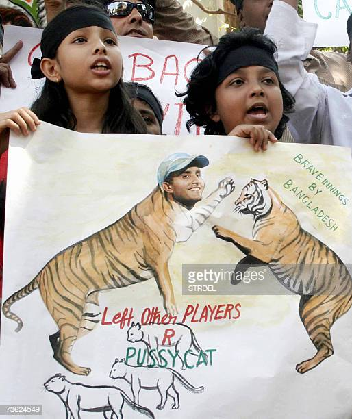 Indian cricket supporters show their support for local favourite Sourav Ganguly as they protest in Kolkata 18 March 2007 after the Indian teams...