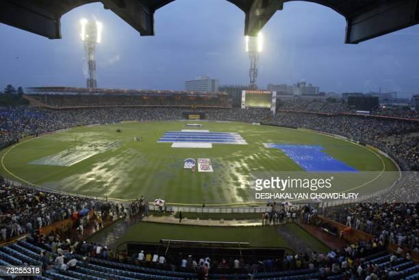 Spectators linger in the stands at Eden Gardens Stadium in Kolkata 08 February 2007 as the One Day International cricket match between India and Sri...