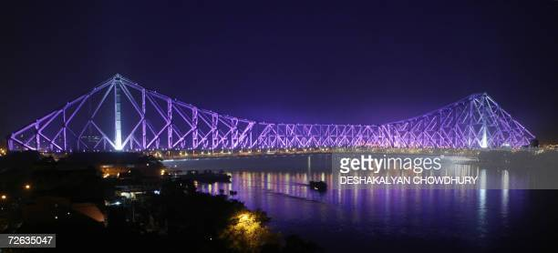 The Howrah Bridge which spans the River Ganges in Kolkata 23 November 2006 is illuminated by coloured lighting The sixtythree year old construction...