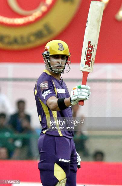 Kolkata Knight Riders batsman Gautam Gambhir raising his bat after making half century during the IPL5 cricket match played between Royal Challengers...