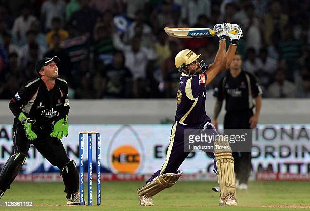 Kolkata Knight Riders batsman Yusuf Pathan hits the ball for a six during the Champions League Twenty20 Group B match between Kolkata Knight Riders...