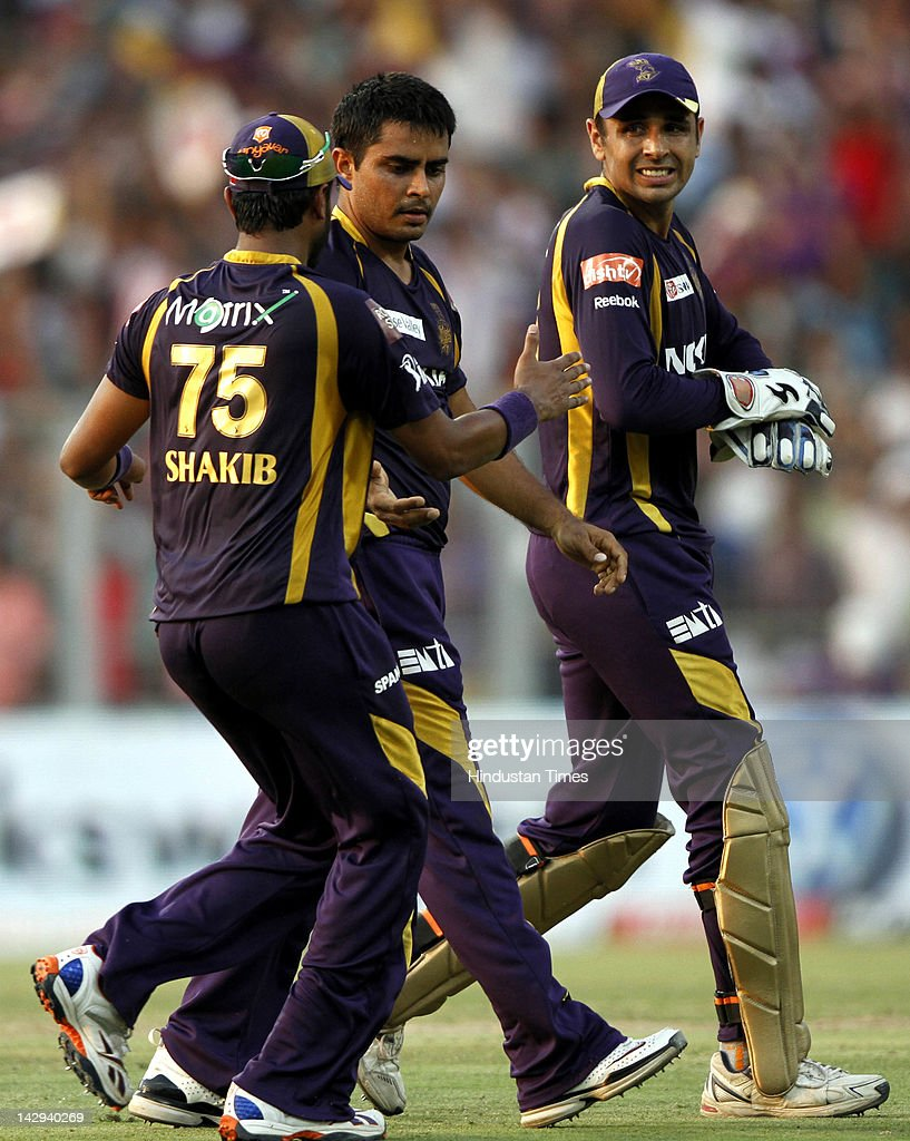 Kolkata Knight Riders bowler Rajat Bhatia (C) celebrating with his teammates Shakib Al Hasan (L) and Manvinder Bisla (R) after dismissal of Kings XI Punjab batsman Paras Dogra during the IPL 5 cricket match played between Kings XI Punjab and Kolkata Knight Riders at Eden Gardens on April 15, 2012 in Kolkata, India. In a nail bitting contest Kings XI Punjab managed to win by 2 runs.