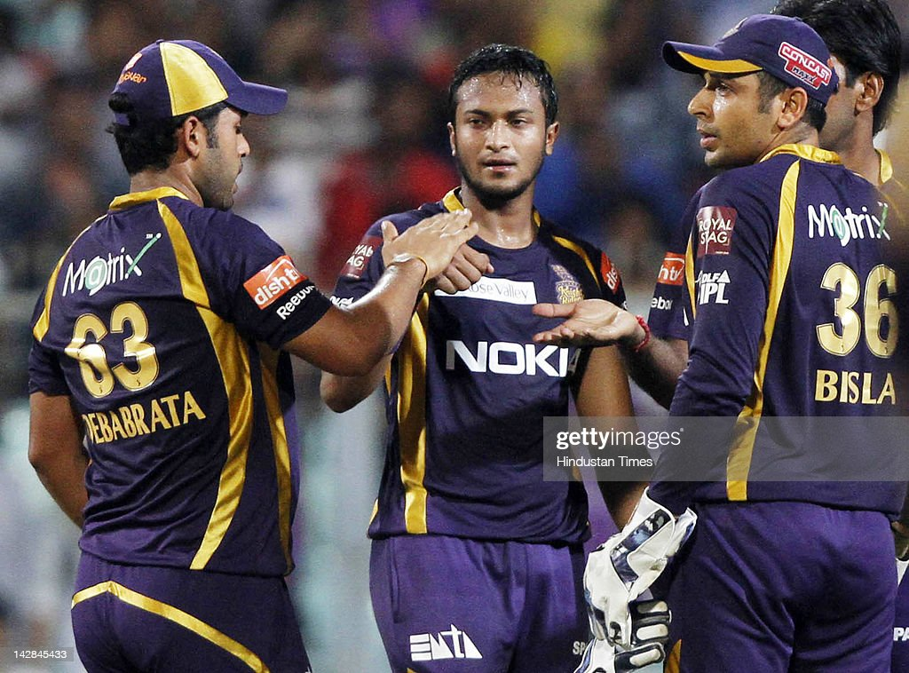 Kolkata Knight Riders bowler <a gi-track='captionPersonalityLinkClicked' href=/galleries/search?phrase=Shakib+Al+Hasan&family=editorial&specificpeople=4145971 ng-click='$event.stopPropagation()'>Shakib Al Hasan</a> (C) celebrating with teammates <a gi-track='captionPersonalityLinkClicked' href=/galleries/search?phrase=Manvinder+Bisla&family=editorial&specificpeople=6838013 ng-click='$event.stopPropagation()'>Manvinder Bisla</a> (R) and Debabrata Das after taking the wicket of Rajasthan Royals batsman Shreevats Goswami during IPL 5 cricket match played between Rajasthan Royals and Kolkata Knight Riders at Eden Garden on April 13, 2012 in Kolkata, India, Kolkata Knight Riders won by 5 wickets with 4 balls remaining.