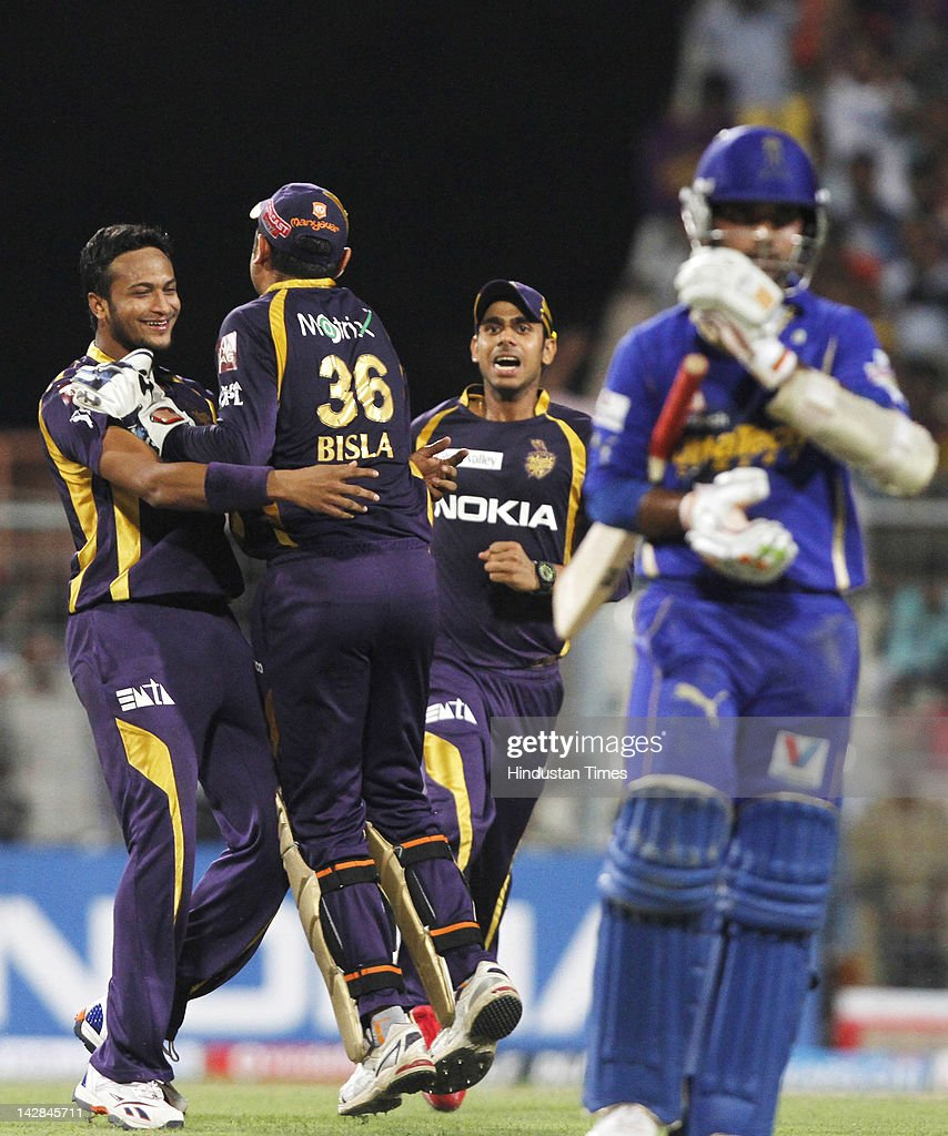 Kolkata Knight Riders bowler <a gi-track='captionPersonalityLinkClicked' href=/galleries/search?phrase=Shakib+Al+Hasan&family=editorial&specificpeople=4145971 ng-click='$event.stopPropagation()'>Shakib Al Hasan</a> (L) celebrating with teammates <a gi-track='captionPersonalityLinkClicked' href=/galleries/search?phrase=Manvinder+Bisla&family=editorial&specificpeople=6838013 ng-click='$event.stopPropagation()'>Manvinder Bisla</a> (2L) and Manoj Tiwari (2R) after taking the wicket of Ajinkya Rahane (R) during IPL 5 cricket match played between Rajasthan Royals and Kolkata Knight Riders at Eden Garden on April 13, 2012 in Kolkata, India, Kolkata Knight Riders won by 5 wickets with 4 balls remaining.