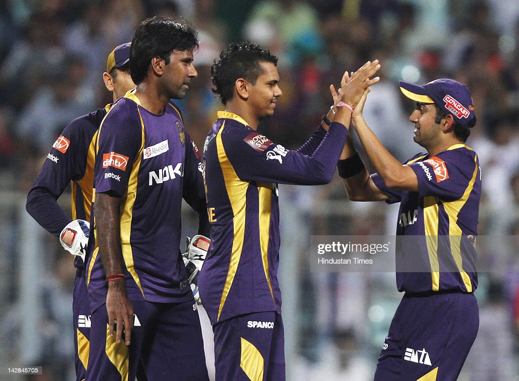 Kolkata Knight Riders bowler Sunil Naraine (C) celebrates with captain <a gi-track='captionPersonalityLinkClicked' href=/galleries/search?phrase=Gautam+Gambhir&family=editorial&specificpeople=707703 ng-click='$event.stopPropagation()'>Gautam Gambhir</a> (R) after taking the wicket of Rajasthan Royals batsman Owais Shah during IPL 5 cricket match played between Rajasthan Royals and Kolkata Knight Riders at Eden Garden on April 13, 2012 in Kolkata, India, Kolkata Knight Riders won by 5 wickets with 4 balls remaining.