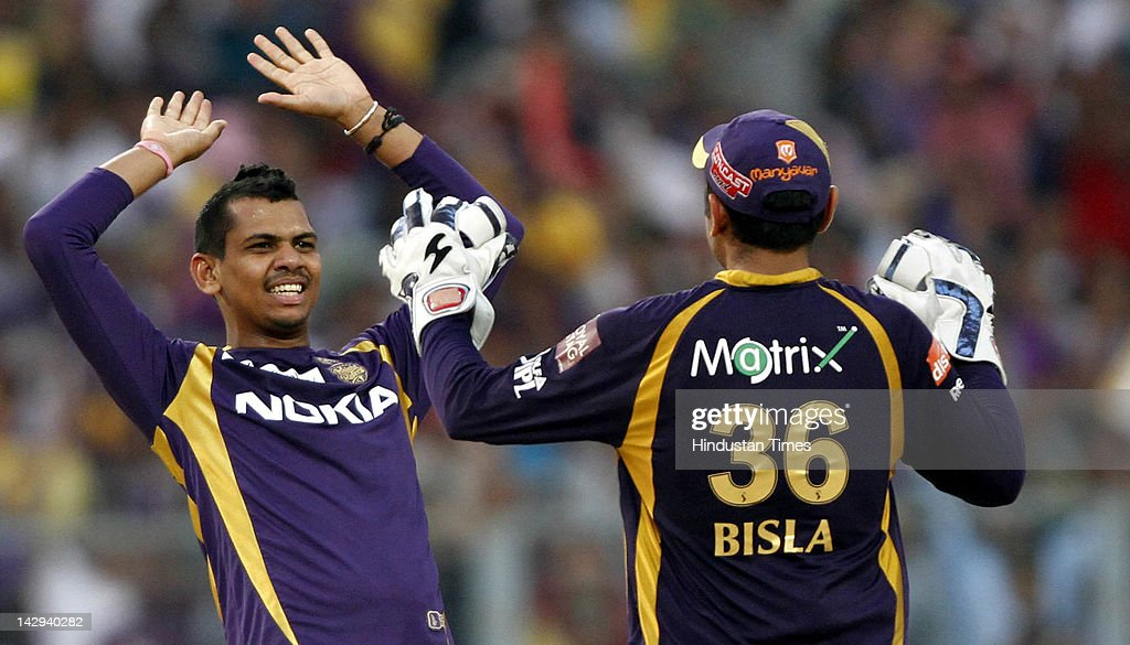 Kolkata Knight Riders bowler Sunil Naraine celebrating with teammate Manvinder Bisla after dismissal of Kings XI Punjab batssman Praveen Kumar during the IPL 5 cricket match played between Kings XI Punjab and Kolkata Knight Riders at Eden Gardens on April 15, 2012 in Kolkata, India. In a nail bitting contest Kings XI Punjab managed to win by 2 runs.