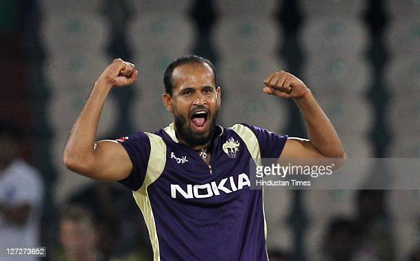 Kolkata Knight Riders bowler Yusuf Pathan celebrates the wicket of South Australian Redbacks batsman Callum Ferguson during the Champions League...