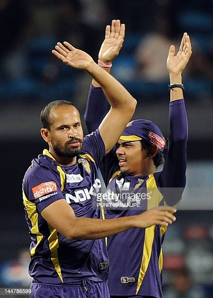 Kolkata Knight Riders bowler Yusuf Pathan celebrates with his teammate Sunil Narine after taking the wicket of Pune Warriors India batsman Michael...