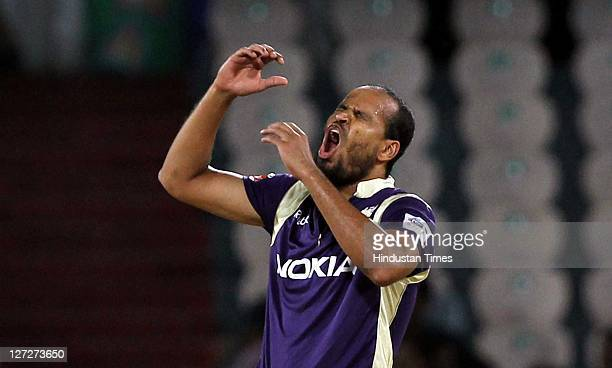 Kolkata Knight Riders bowler Yusuf Pathan reacts after his teammate Jacques Kallis drops the catch of Redbacks batsman Callum Ferguson during the...