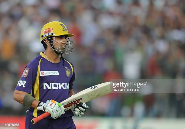 Kolkata Knight Riders captain Gautam Gambhir walks back to the pavallion after his dismissal by Rajasthan Royals bowler Amit Singh during the IPL...