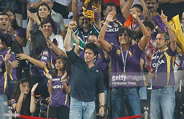 Kolkata Knight Riders coowner Shah Rukh Khan with his daughter Suhana and actor Chunky Pandey cheer for his team against Delhi Daredevils during the...