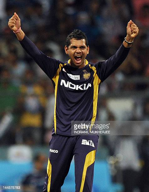 Kolkata Knight Riders cricketer Sunil Narine reacts after taking the wicket of unseen Mumbai Indians batsman Rohit Sharma during the IPL Twenty20...