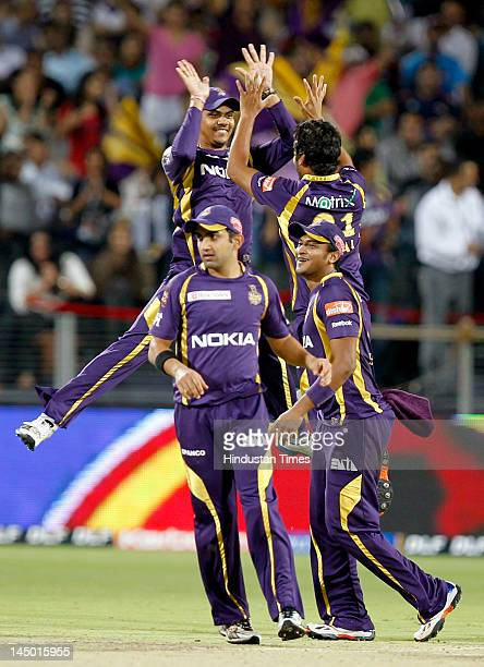 Kolkata Knight Riders player Iqbal Abdulla celebrates with his teammates Shakib Al Hasan Sunil Narine and Goutam Gambir after the wicket of Delhi...