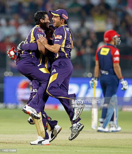 Kolkata Knight Riders player Shakib Al Hasan celebrates with his teammates after the wicket of Delhi Daredevils batsman David Warner during the first...