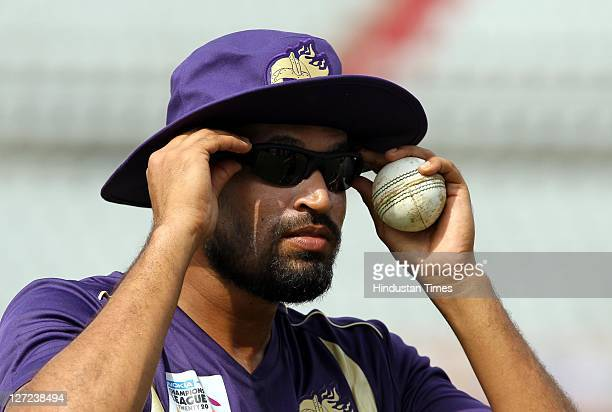 Kolkata Knight Riders player Yusuf Pathan checking the new 'EYE CAM GOGGLE' during a practice session on the eve of their Champions League T20 match...