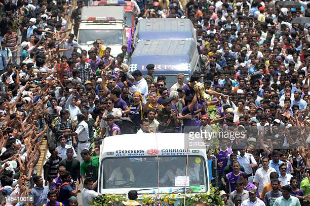Kolkata Knight Riders players and officials ride on a truck with the tournament trophy during a victory procession to the Eden Gardens in Kolkata on...