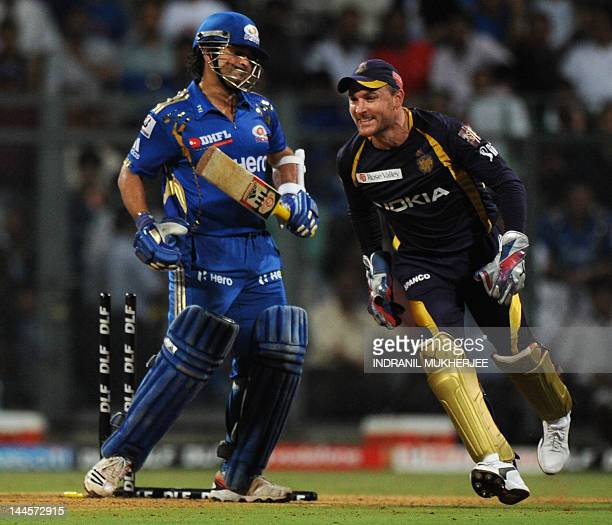 Kolkata Knight Riders wicket keeper Brendon McCullum reacts after Mumbai Indians batsman Sachin Tendulkar is bowled out by unseen teammate Sunil...