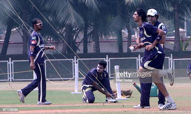 Kolkata Night Riders player Murali Karthik and Ishant Sharma at a practice session in Mumbai on March 11 2010 Coach Wasim Akram can also be seen in...