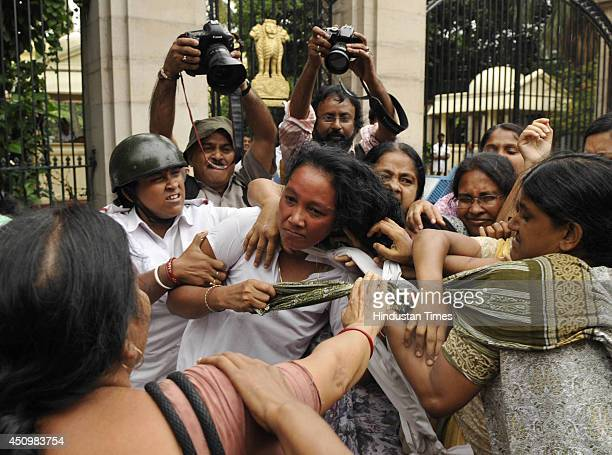 Kolkata police constables trying to stop SUCI party workers as they protest against rail fare hike in front of Raj Bhavan North Gate on June 21 2014...