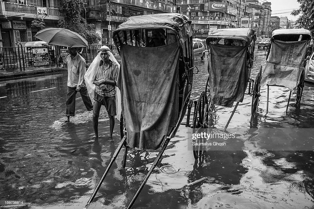 CONTENT] Kolkata streets are waterlogged after heavy monsoon. Some busy roads are merely empty. Hand pulled rickshaw drivers are waiting for business.