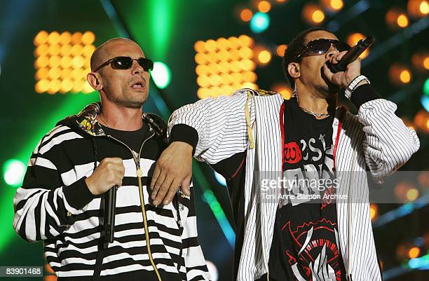 Koll Shen and Joey Starr of NTM perform at the France 2 Television's 'Fete de la Musique' at the Auteuil Horse track on June 21 2008 in Paris France
