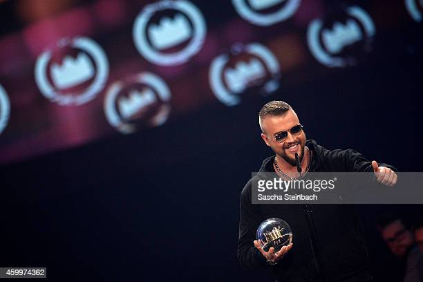 'Kollegah' alias Felix Blume celebrates winning the 1Live Krone award during the 1Live Krone 2014 at Jahrhunderthalle on December 4 2014 in Bochum...