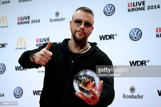 'Kollegah' alias Felix Blume poses with the award during the 1Live Krone 2014 at Jahrhunderthalle on December 4 2014 in Bochum Germany