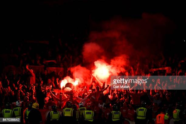Koln Fans let of flares after Jhon Cordoba of FC Koeln scored the first goal during the UEFA Europa League group H match between Arsenal FC and 1 FC...
