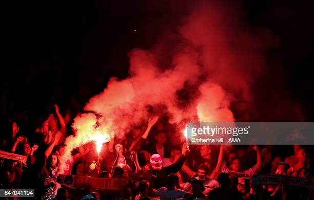 Koln fans light flares during the UEFA Europa League group H match between Arsenal FC and 1 FC Koeln at Emirates Stadium on September 14 2017 in...