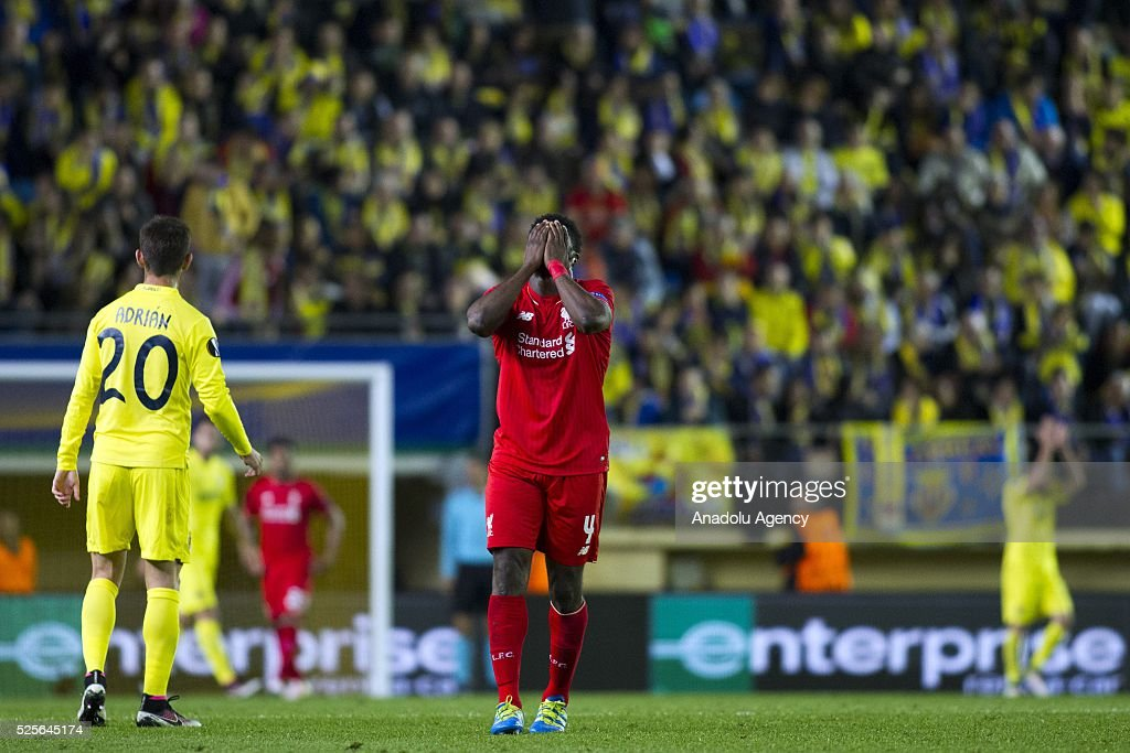 Kolo Tour�� (R) of Liverpool gestures after loosing the UEFA Europa League Semi Final match between Villarreal and Liverpool at Estadio El Madrigal in Villareal, Spain on April 28, 2016.
