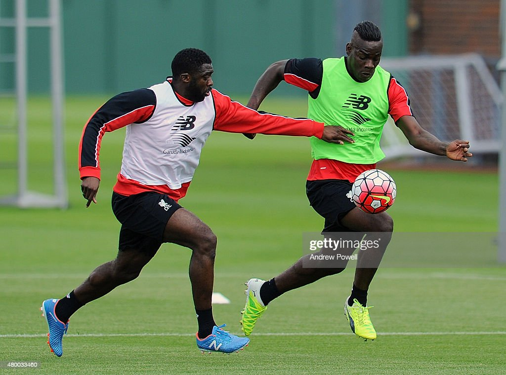 Kolo Toure and Mario Balotelli of Liverpool during a training session at Melwood Training Ground on July 9, 2015 in Liverpool, England.
