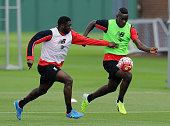 Kolo Toure and Mario Balotelli of Liverpool during a training session at Melwood Training Ground on July 9 2015 in Liverpool England