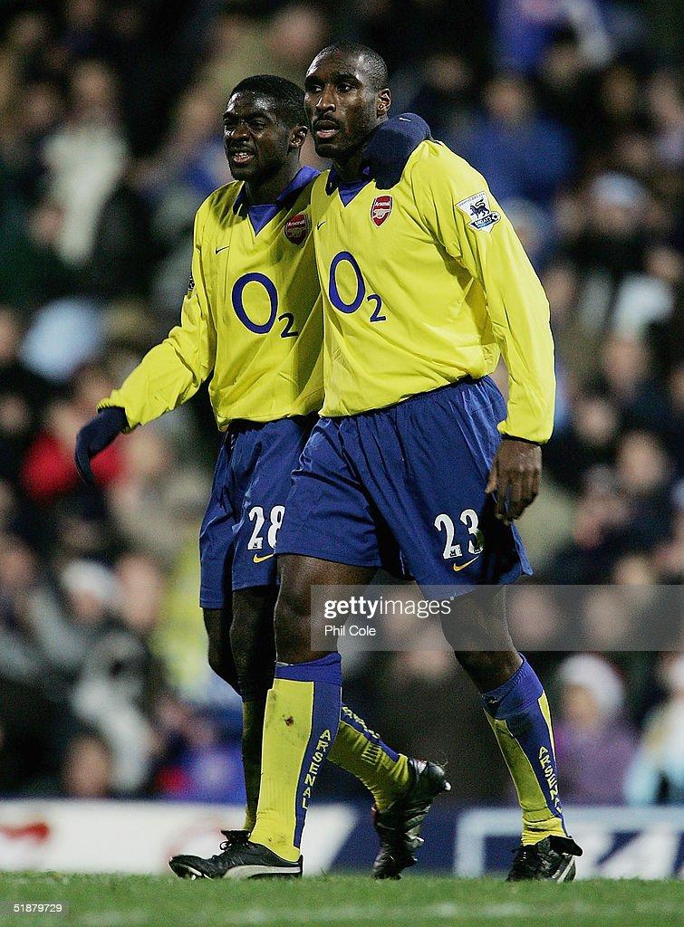 Kolo Toure congratulates Sol Campbell, the goal scorer, at the end of the Barclays Premiership match between Portsmouth and Arsenal at Fratton Park on December 19, 2004 in London, England.