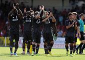 Kolo Toure Lazar Markovic Sheyi Ojo Alberto Moreno and Joao Teixeira of Liverpool shows their appreciation to the fans at the end of a preseason...