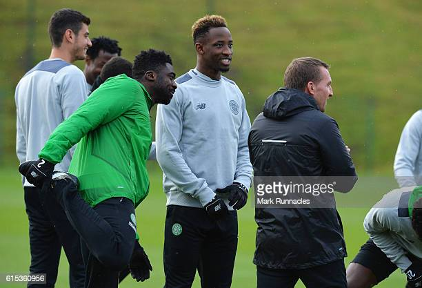 Kolo Toure Moussa Dembele and Brendan Rodgers manager of Celtic look on during a Celtic training session on the eve of their UEFA Champions League...