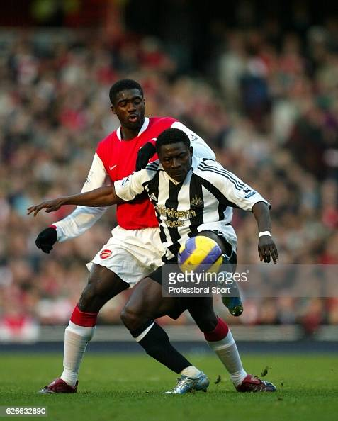Kolo Toure of Arsenal challenges Obafemi Martins of Newcastle during the Barclays Premiership match between Arsenal and Newcastle United at the...